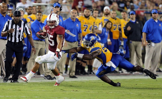 Sep 7, 2013; Stanford, CA, USA; Stanford Cardinal running back Tyler Gaffney (25) escapes away from San Jose State Spartans linebacker Sean Bacon (95) during the third quarter at Stanford Stadium. The Stanford Cardinal defeated the San Jose State Spartans 34-13. Mandatory Credit: Kelley L Cox-USA TODAY Sports