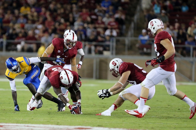 Sep 7, 2013; Stanford, CA, USA; Stanford Cardinal cornerback Wayne Lyons (2) forces and recovers the fumble by San Jose State Spartans wide receiver Jabari Carr (1) during the third quarter at Stanford Stadium. The Stanford Cardinal defeated the San Jose State Spartans 34-13. Mandatory Credit: Kelley L Cox-USA TODAY Sports