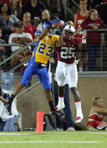 Sep 7, 2013; Stanford, CA, USA; San Jose State Spartans wide receiver Noel Grigsby (23) catches the touchdown pass against Stanford Cardinal cornerback Alex Carter (25) during the third quarter at Stanford Stadium. The Stanford Cardinal defeated the San Jose State Spartans 34-13. Mandatory Credit: Kelley L Cox-USA TODAY Sports