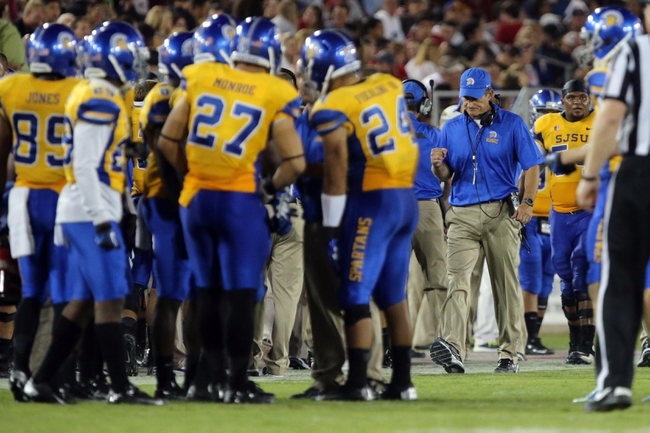 Sep 7, 2013; Stanford, CA, USA; San Jose State Spartans head coach Ron Caragher clenches his fist as he approaches the huddle after a touchdown against the San Jose State Spartans during the third quarter at Stanford Stadium. The Stanford Cardinal defeated the San Jose State Spartans 34-13. Mandatory Credit: Kelley L Cox-USA TODAY Sports
