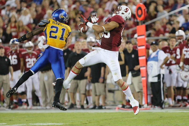 Sep 7, 2013; Stanford, CA, USA; San Jose State Spartans cornerback Bene Benwikere (21) breaks up the pass intended for Stanford Cardinal wide receiver Devon Cajuste (89) during the third quarter at Stanford Stadium. The Stanford Cardinal defeated the San Jose State Spartans 34-13. Mandatory Credit: Kelley L Cox-USA TODAY Sports