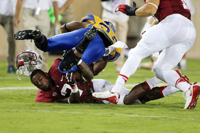 Sep 7, 2013; Stanford, CA, USA; Stanford Cardinal cornerback Wayne Lyons (2) loses his helmet making the tackle against San Jose State Spartans running back Jason Simpson (32) during the third quarter at Stanford Stadium. The Stanford Cardinal defeated the San Jose State Spartans 34-13. Mandatory Credit: Kelley L Cox-USA TODAY Sports
