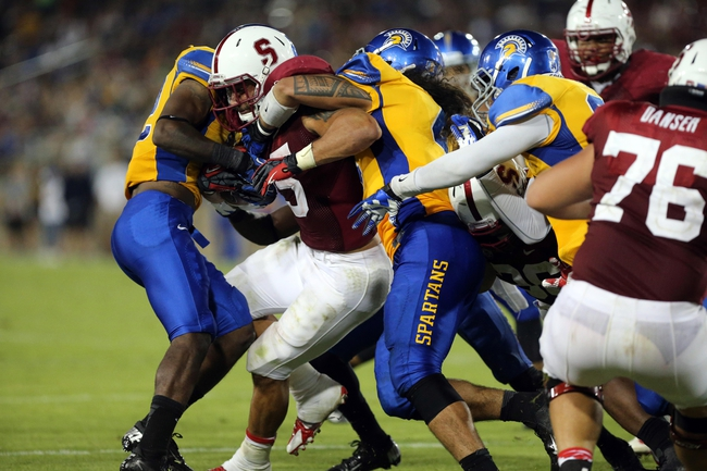 Sep 7, 2013; Stanford, CA, USA; Stanford Cardinal quarterback Evan Crower (5) carries the ball against the San Jose State Spartans during the fourth quarter at Stanford Stadium. The Stanford Cardinal defeated the San Jose State Spartans 34-13. Mandatory Credit: Kelley L Cox-USA TODAY Sports