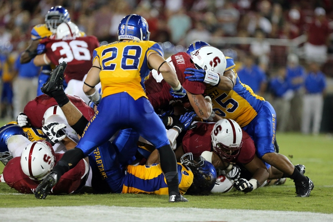 Sep 7, 2013; Stanford, CA, USA; Stanford Cardinal running back Tyler Gaffney (25) scores a touchdown against the San Jose State Spartans during the fourth quarter at Stanford Stadium. The Stanford Cardinal defeated the San Jose State Spartans 34-13. Mandatory Credit: Kelley L Cox-USA TODAY Sports