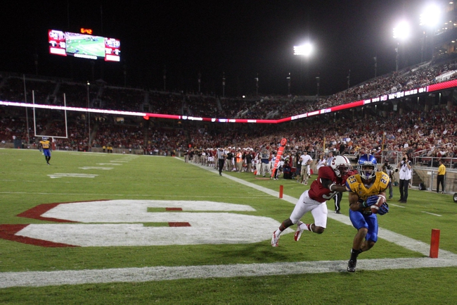 Sep 7, 2013; Stanford, CA, USA; San Jose State Spartans wide receiver Noel Grigsby (23) catches the ball out of bounds ahead of Stanford Cardinal cornerback Barry Browning (31) during the fourth quarter at Stanford Stadium. The Stanford Cardinal defeated the San Jose State Spartans 34-13. Mandatory Credit: Kelley L Cox-USA TODAY Sports
