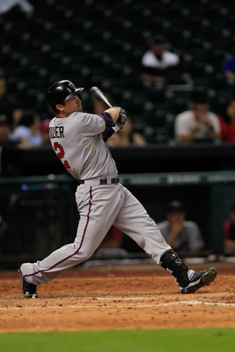 Sep 3, 2013; Houston, TX, USA; Minnesota Twins second baseman Brian Dozier (2) bats against the Houston Astros during the eleventh inning at Minute Maid Park. Mandatory Credit: Thomas Campbell-USA TODAY Sports
