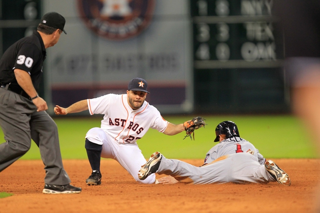 Sep 3, 2013; Houston, TX, USA; Houston Astros second baseman Jose Altuve (27) tags Minnesota Twins left fielder Alex Presley (1) as umpire Rob Drake (30) watches during the tenth inning at Minute Maid Park. Mandatory Credit: Thomas Campbell-USA TODAY Sports