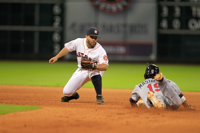 Sep 3, 2013; Houston, TX, USA; Minnesota Twins center fielder Darin Mastroianni (19) slides into second base past Houston Astros second baseman Jose Altuve (27) during the eleventh inning at Minute Maid Park. Mandatory Credit: Thomas Campbell-USA TODAY Sports