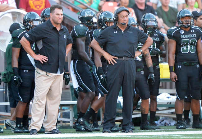 Aug 29, 2013; Honolulu, HI, USA; Hawaii Rainbow Warriors coach Norm Chow (center) and special teams coordinator reacts Chris Demarest (left) react during the game against the Southern California Trojans at Aloha Stadium. USC defeated Hawaii 30-13. Mandatory Credit: Kirby Lee-USA TODAY Sports