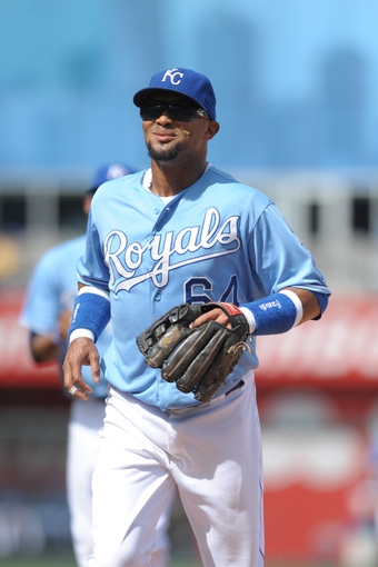 Sep 5, 2013; Kansas City, MO, USA; Kansas City Royals second baseman Emilio Bonifacio (64) returns to the dugout in between innings of the game against the Seattle Mariners at Kauffman Stadium. The Royals won 7-6. Mandatory Credit: Denny Medley-USA TODAY Sports