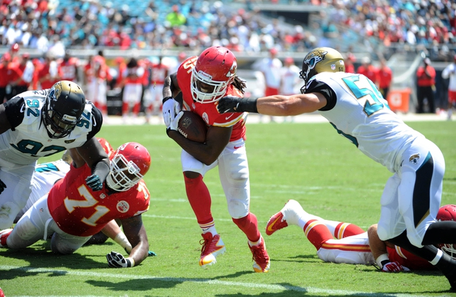 Sep 8, 2013; Jacksonville, FL, USA; Kansas City Chiefs running back Jamaal Charles (25) runs the ball for a touchdown during the game against the Jacksonville Jaguars at EverBank Field. Mandatory Credit: Melina Vastola-USA TODAY Sports
