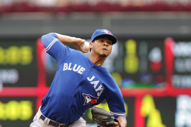 Sep 8, 2013; Minneapolis, MN, USA; Toronto Blue Jays pitcher Esmil Rogers (32) throws a pitch during the first inning against the Minnesota Twins at Target Field.  Mandatory Credit: Brad Rempel-USA TODAY Sports