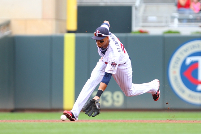Sep 8, 2013; Minneapolis, MN, USA; Minnesota Twins shortstop Pedro Florimon (25) fields a ground ball during the first inning against Toronto Blue Jay at Target Field.  Mandatory Credit: Brad Rempel-USA TODAY Sports