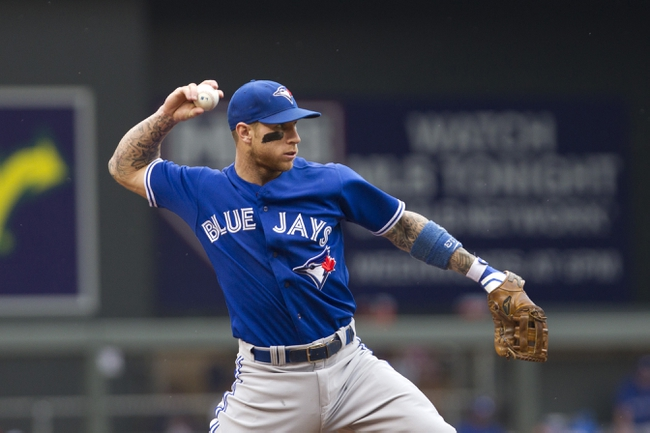 Sep 8, 2013; Minneapolis, MN, USA; Toronto Blue Jays third baseman Brett Lawrie throws the ball to first base during the first inning against Minnesota Twins at Target Field.  Mandatory Credit: Brad Rempel-USA TODAY Sports