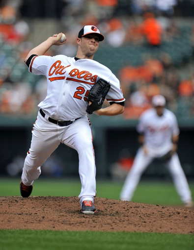 Sep 8, 2013; Baltimore, MD, USA; Baltimore Orioles starting pitcher Bud Norris (25) throws in the third inning against the Chicago White Sox at Oriole Park at Camden Yards. Mandatory Credit: Joy R. Absalon-USA TODAY Sports