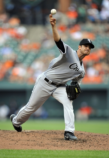 Sep 8, 2013; Baltimore, MD, USA; Chicago White Sox starting pitcher Andr   Rienzo (64) throws in the third inning against the Baltimore Orioles Sox at Oriole Park at Camden Yards. Mandatory Credit: Joy R. Absalon-USA TODAY Sports