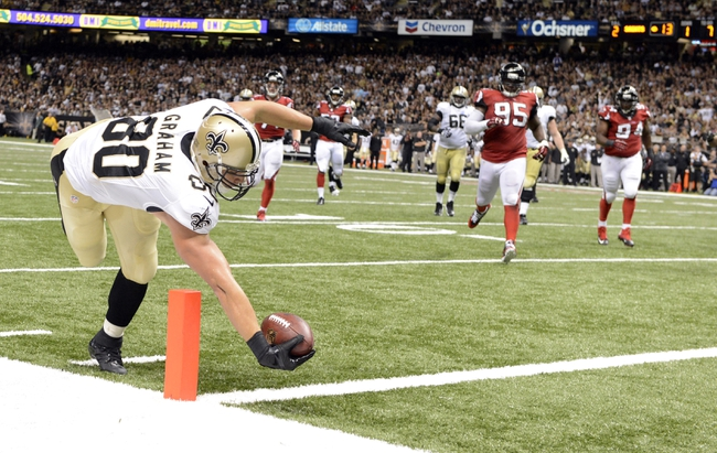 Sep 8, 2013; New Orleans, LA, USA; New Orleans Saints tight end Jimmy Graham (80) reaches out to the goal line against the Atlanta Falcons during the third quarter at the Mercedes-Benz Superdome. Mandatory Credit: John David Mercer-USA TODAY Sports