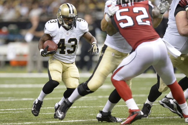Sep 8, 2013; New Orleans, LA, USA; New Orleans Saints running back Darren Sproles (43) carries the ball against the Atlanta Falcons during the third quarter at the Mercedes-Benz Superdome. Mandatory Credit: John David Mercer-USA TODAY Sports