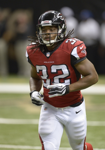 Sep 8, 2013; New Orleans, LA, USA; Atlanta Falcons running back Jacquizz Rodgers (32) returns to the sidelines against the New Orleans Saints during the third quarter at the Mercedes-Benz Superdome. Mandatory Credit: John David Mercer-USA TODAY Sports