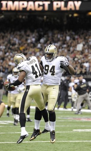 Sep 8, 2013; New Orleans, LA, USA; New Orleans Saints strong safety Roman Harper (41) celebrates his interception with defensive end Cameron Jordan (94) ending the Atlanta Falcons drive with less than a minute to go in the fourth quarter at the Mercedes-Benz Superdome. The New Orleans Saints defeated the Atlanta Falcons 23-17. Mandatory Credit: John David Mercer-USA TODAY Sports