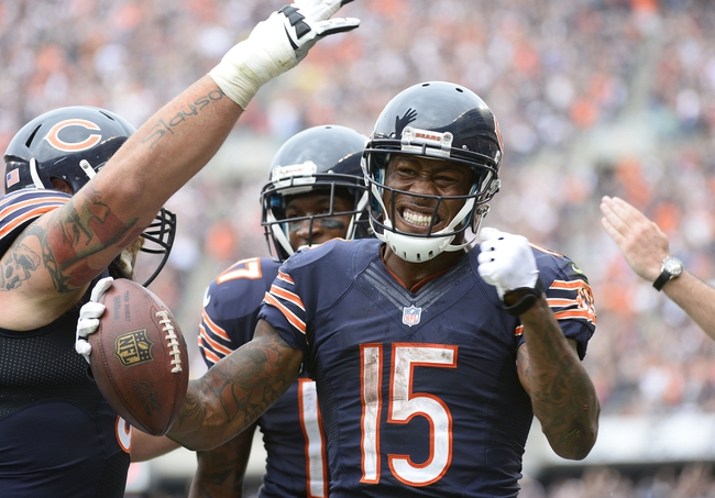 Sep 8, 2013; Chicago, IL, USA; Chicago Bears wide receiver Brandon Marshall (15) reacts after making a touchdown catch against the Cincinnati Bengals during the fourth quarter at Soldier Field. Chicago defeats Cincinnati 24-21. Mandatory Credit: Mike DiNovo-USA TODAY Sports