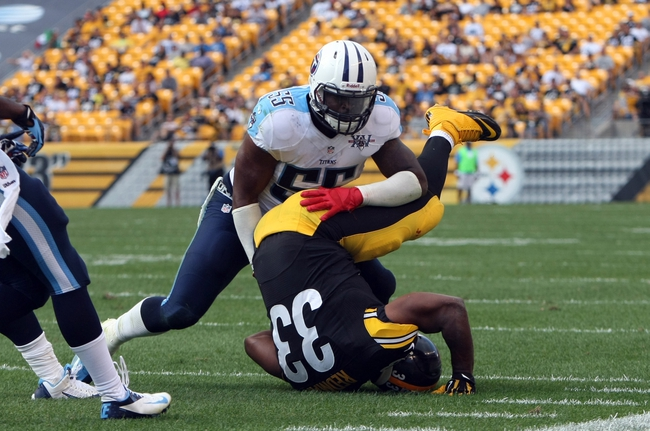 Sep 8, 2013; Pittsburgh, PA, USA; Tennessee Titans linebacker Zach Brown (55) tackles Pittsburgh Steelers running back Isaac Redman (33) during the second half at Heinz Field. The Titans won the game, 16-9. Mandatory Credit: Jason Bridge-USA TODAY Sports