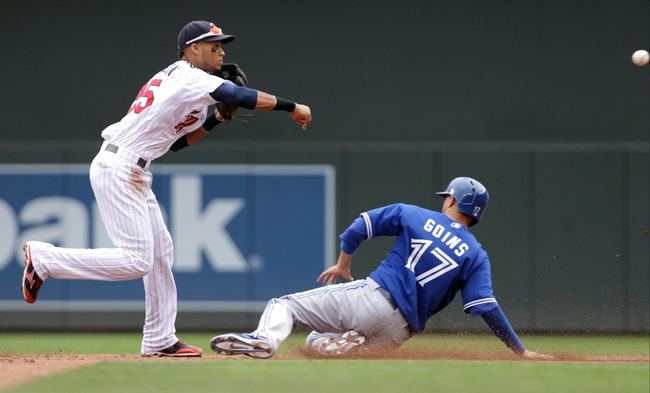 Sep 8, 2013; Minneapolis, MN, USA; Minnesota Twins Minnesota Twins shortstop Pedro Florimon (25)  completes the double play as Toronto Blue Jays infielder Ryan Goins (17)  slides into second during the fifth inning against the Toronto Blue Jays at Target Field.  Mandatory Credit: Brad Rempel-USA TODAY Sports