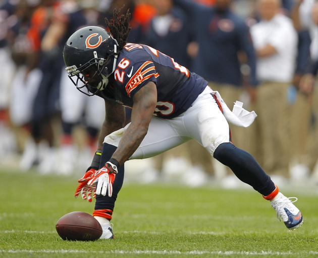 Sep 8, 2013; Chicago, IL, USA; Chicago Bears cornerback Tim Jennings (26) picks up a loose ball during the second half against the Cincinnati Bengals at Soldier Field. Chicago won 24-21. Mandatory Credit: Dennis Wierzbicki-USA TODAY Sports