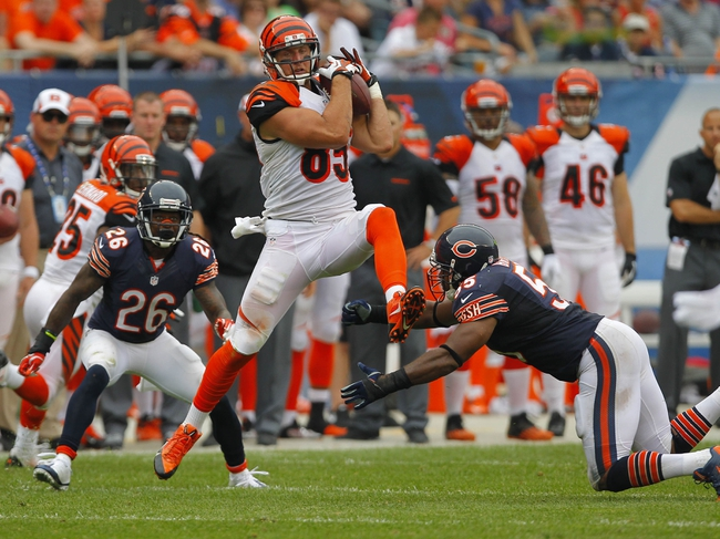 Sep 8, 2013; Chicago, IL, USA; Cincinnati Bengals tight end Tyler Eifert (center) makes a catch between Chicago Bears cornerback Tim Jennings (left) and Bears outside linebacker Lance Briggs (right) during the second half at Soldier Field. Chicago won 24-21. Mandatory Credit: Dennis Wierzbicki-USA TODAY Sports