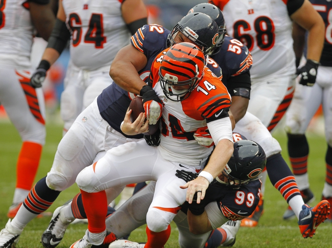 Sep 8, 2013; Chicago, IL, USA; Chicago Bears defensive tackle Stephen Paea (92) sacks Cincinnati Bengals quarterback Andy Dalton (14) during the second half at Soldier Field. Chicago won 24-21. Mandatory Credit: Dennis Wierzbicki-USA TODAY Sports