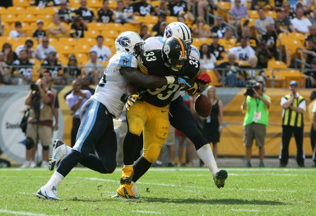 Sep 8, 2013; Pittsburgh, PA, USA; Tennessee Titans linebackers Moise Fokou (53) and Zach Brown (55) break up a pass to Pittsburgh Steelers running back Isaac Redman (33) during the second half at Heinz Field. The Titans won the game, 16-9. Mandatory Credit: Jason Bridge-USA TODAY Sports