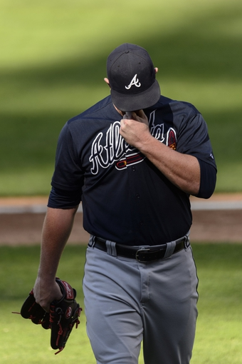 Sep 8, 2013; Philadelphia, PA, USA; Atlanta Braves pitcher David Carpenter (48) walks off the field after pitching the with inning against the Philadelphia Phillies at Citizens Bank Park. The Phillies defeated the Braves 3-2. Mandatory Credit: Howard Smith-USA TODAY Sports