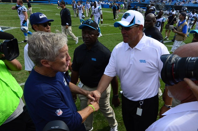 Sep 8, 2013; Charlotte, NC, USA; Seattle Seahawks head coach Pete Carroll shakes hands with Carolina Panthers head coach Ron Rivera after the game. The Seahawks defeated the Panthers 12-7 at Bank of America Stadium. Mandatory Credit: Bob Donnan-USA TODAY Sports