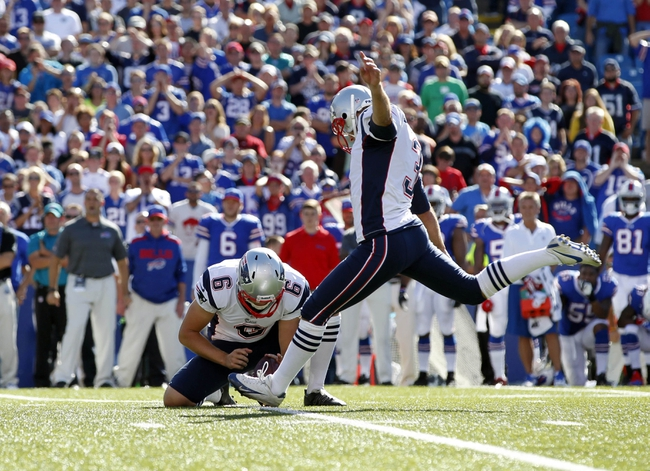 Sep 8, 2013; Orchard Park, NY, USA; New England Patriots kicker Stephen Gostkowski (3) kicks a field goal to win the game as punter Ryan Allen (6) holds during the fourth quarter against the Buffalo Bills at Ralph Wilson Stadium. Patriots beat the Bills 23-21. Mandatory Credit: Kevin Hoffman-USA TODAY Sports