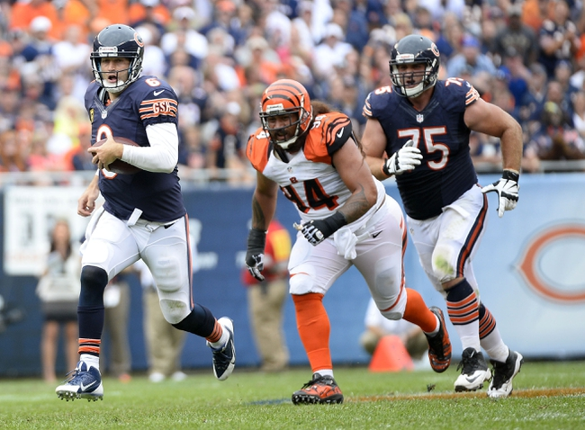 Sep 8, 2013; Chicago, IL, USA;  Chicago Bears quarterback Jay Cutler (6) rushes the ball against Cincinnati Bengals defensive tackle Domata Peko (94) during the fourth quarter at Soldier Field. Chicago defeats Cincinnati 24-21. Mandatory Credit: Mike DiNovo-USA TODAY Sports