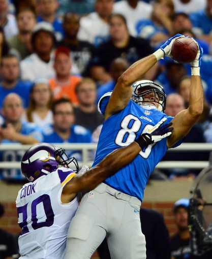 Sep 8, 2013; Detroit, MI, USA; Detroit Lions tight end Michael Williams (89) makes a catch while being defended by Minnesota Vikings cornerback Chris Cook (20) in the fourth quarter at Ford Field. Mandatory Credit: Andrew Weber-USA TODAY Sports