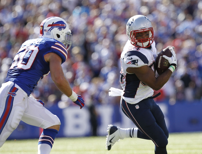 Sep 8, 2013; Orchard Park, NY, USA; Buffalo Bills inside linebacker Kiko Alonso (50) pursues New England Patriots running back Shane Vereen (34) during the fourth quarter at Ralph Wilson Stadium. Patriots beat the Bills 23-21. Mandatory Credit: Kevin Hoffman-USA TODAY Sports