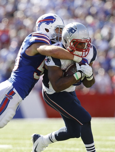 Sep 8, 2013; Orchard Park, NY, USA; Buffalo Bills inside linebacker Kiko Alonso (50) tackles New England Patriots running back Shane Vereen (34) during the fourth quarter at Ralph Wilson Stadium. Patriots beat the Bills 23-21. Mandatory Credit: Kevin Hoffman-USA TODAY Sports