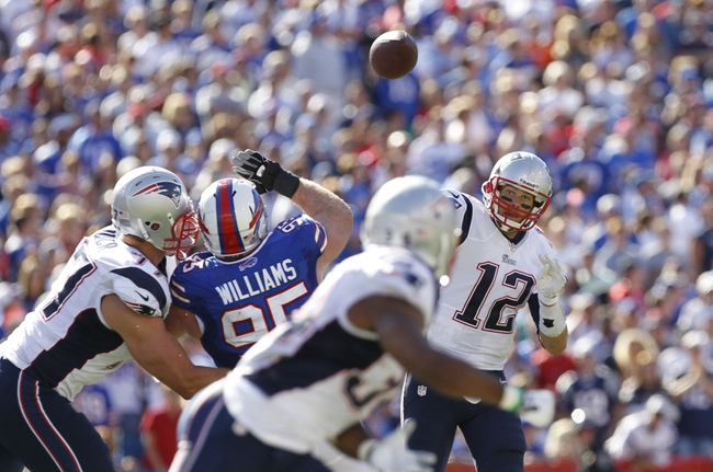 Sep 8, 2013; Orchard Park, NY, USA; New England Patriots quarterback Tom Brady (12) passes to running back Shane Vereen (34) as Buffalo Bills defensive tackle Kyle Williams (95) rushes during the fourth quarter at Ralph Wilson Stadium. Patriots beat the Bills 23-21. Mandatory Credit: Kevin Hoffman-USA TODAY Sports