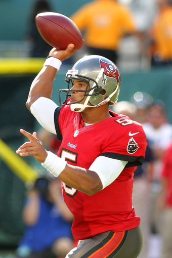 Sep 8, 2013; East Rutherford, NJ, USA; Tampa Bay Buccaneers quarterback Josh Freeman (5) passes against the New York Jets during the fourth quarter of a game at MetLife Stadium. The Jets won 18-17. Mandatory Credit: Brad Penner-USA TODAY Sports