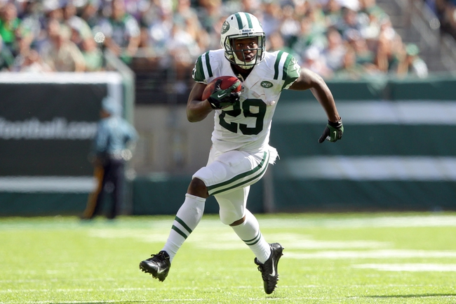 Sep 8, 2013; East Rutherford, NJ, USA; New York Jets running back Bilal Powell (29) rushes with the ball against the Tampa Bay Buccaneers during the fourth quarter of a game at MetLife Stadium. The Jets won 18-17. Mandatory Credit: Brad Penner-USA TODAY Sports