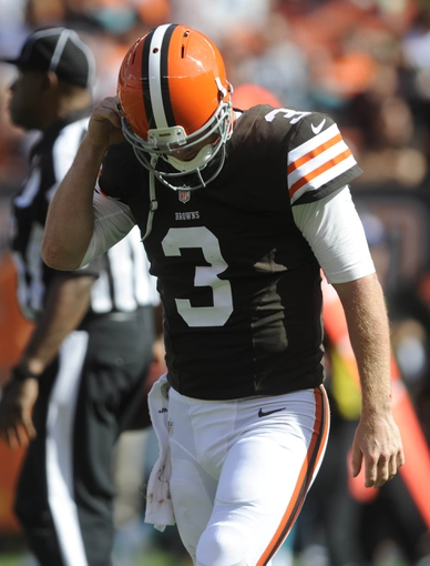 Sep 8, 2013; Cleveland, OH, USA; Cleveland Browns quarterback Brandon Weeden (3) walks off the field after being sacked during the fourth quarter against the Miami Dolphins at FirstEnergy Stadium. Mandatory Credit: Ken Blaze-USA TODAY Sports