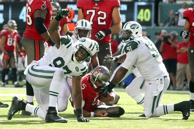 Sep 8, 2013; East Rutherford, NJ, USA; New York Jets linebacker Calvin Pace (97) reacts after sacking Tampa Bay Buccaneers quarterback Josh Freeman (5) during the fourth quarter of a game at MetLife Stadium. The Jets won 18-17. Mandatory Credit: Brad Penner-USA TODAY Sports
