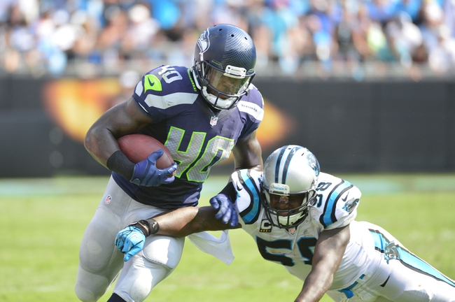 Sep 8, 2013; Charlotte, NC, USA; Seattle Seahawks running back Derrick Coleman (40) runs as Carolina Panthers outside linebacker Thomas Davis (58) defends in the fourth quarter. The Seahawks defeated the Panthers 12-7 at Bank of America Stadium. Mandatory Credit: Bob Donnan-USA TODAY Sports