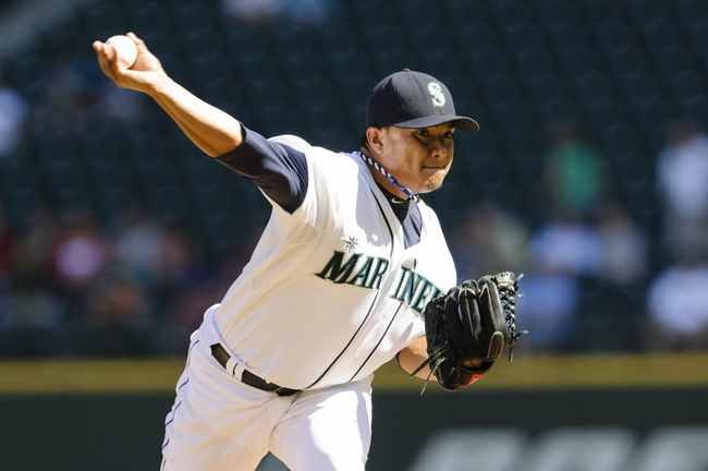 Sep 8, 2013; Seattle, WA, USA; Seattle Mariners starting pitcher Erasmo Ramirez (50) pitches to the Tampa Bay Rays during the 1st inning at Safeco Field. Mandatory Credit: Steven Bisig-USA TODAY Sports
