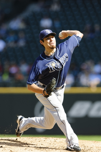 Sep 8, 2013; Seattle, WA, USA; Tampa Bay Rays starting pitcher Matt Moore (55) pitches to the Seattle Mariners during the 1st inning at Safeco Field. Mandatory Credit: Steven Bisig-USA TODAY Sports