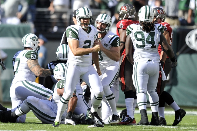 Sep 8, 2013; East Rutherford, NJ, USA; New York Jets kicker Nick Folk (2) celebrates his game winning field goal against the Tampa Bay Buccaneers during the second half at MetLife Stadium. The Jets won 18-17. Mandatory Credit: Joe Camporeale-USA TODAY Sports