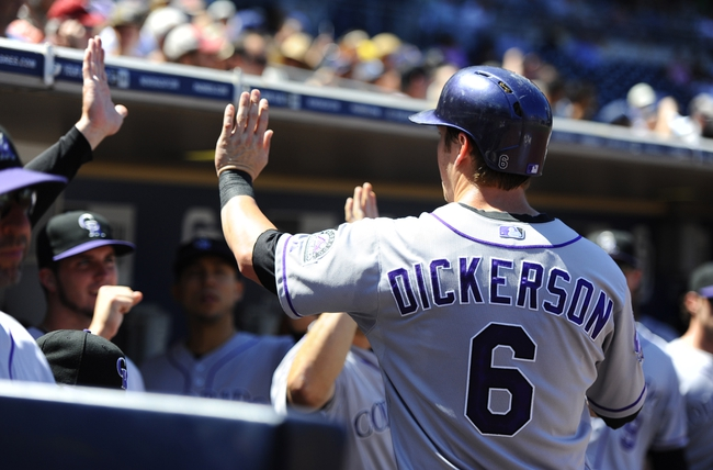 Sep 8, 2013; San Diego, CA, USA; Colorado Rockies left fielder Corey Dickerson (6) is congratulated by teammates after scoring during the third inning against the San Diego Padres at Petco Park. Mandatory Credit: Christopher Hanewinckel-USA TODAY Sports