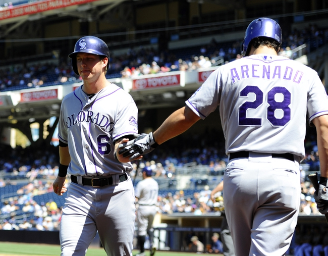 Sep 8, 2013; San Diego, CA, USA; Colorado Rockies left fielder Corey Dickerson (6) is congratulated by third baseman Nolan Arenado (28) after scoring during the third inning against the San Diego Padres at Petco Park. Mandatory Credit: Christopher Hanewinckel-USA TODAY Sports