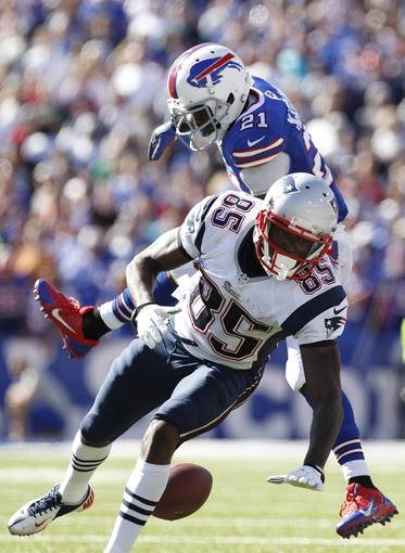Sep 8, 2013; Orchard Park, NY, USA; New England Patriots wide receiver Kenbrell Thompkins (85) drops a pass after a hit by Buffalo Bills cornerback Leodis McKelvin (21) during the fourth quarter at Ralph Wilson Stadium. Patriots beat the Bills 23-21. Mandatory Credit: Kevin Hoffman-USA TODAY Sports